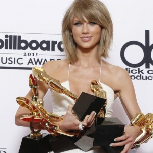 "Taylor Swift poses in the press room with the awards for top Billboard 200 album for ""1989"", top female artist, chart achievement, top artist, top Billboard 200 artist, top hot 100 artist, top digital song artist, and top streaming song (video) for ""Shake It Off"" at the Billboard Music Awards at the MGM Grand Garden Arena on Sunday, May 17, 2015, in Las Vegas. (Photo by Eric Jamison/Invision/AP)"