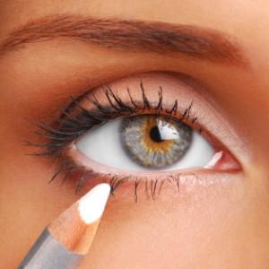 Women eye. White Cosmetic pencil. Make-up tool. White eyeliner